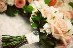 Personalized touches to the bouquet's handle are always some of the most memorable details of your special day.