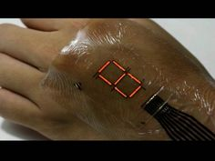 E-skin Technology Turns Your Body Into Screen With Digital Display  This electronic skin display can help people in hospitals measure blood oxygen levels and pulse rates, while also helping athletes track their progress during training. It sounds promising since this ultrathin and ultraflexible device is less than 2 micrometers thick.  (Photo : University of Tokyo)        Forget about smartwaches. The newest breakthrough in biomedical technology turns the body into a screen, displayi..