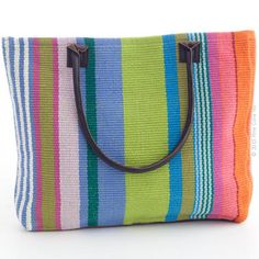 In varying shades of citrus, blue, orange, pink, and green, Mellie Stripe carryall woven cotton tote bag is a bright addition to any outfit or room. With a generous capacity and genuine leather handles and bottom, this durable tote is both practical and fashionable.