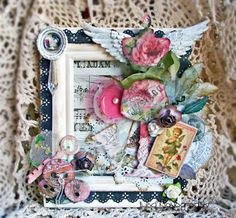 Altered frame using the Scraps of Elegance May kit.