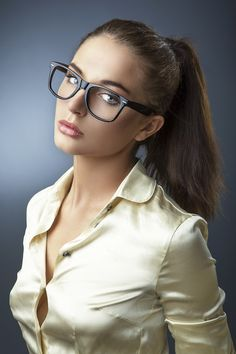 wow that gap in the blouse - wearing glasses - you just know there is more going on....