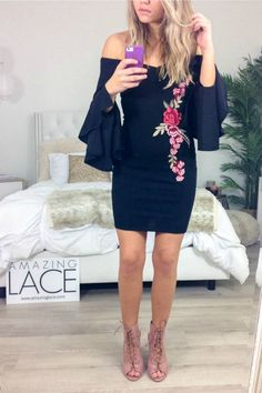 - Fancy black bell sleeved dress features rose embroidery - Bell sleeves hug the shoulder - Material is Polyester and Spandex - Not Lined - Model Elizabeth is 5'6 and is wearing a small Bust Length Sm