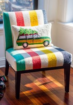 a chair covered in a Hudson's Bay striped point blanket has a colorful jeep wagoneer hauling home the Christmas tree pillow - equal parts Colorful Christmas Cheer and Campy Kitsch! Hudson Bay Blanket, Theme Noel, Apartment Living, Apartment Therapy, Take A Seat, My Living Room, Bunt, Home Furniture, Modern Furniture