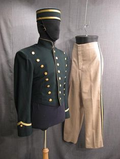 Costume: Bellhop Uniform w hat green tan (Esteban Julio Ricardo Montoya de la Rosa Ramirez costume)