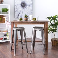 With its sturdy steel construction, these steel stools offer a vintage industrial look. These bar-height stools are fully assembled, stackable and feature non-mar foot glides.