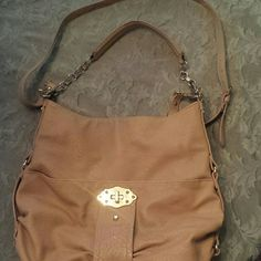 Jessica Simpson faux leather large crossbody tote Jessica Simpson faux leather large crossbody tote bag.   Great spring tan color with lots of gold accents/hardware!  2 large external pockets~ one eith snap closure, the other with moving dial.   Inside internal zip pocket and two sleeve pockets.   Crossbody strap that is detachable, adjustable shoulder strap.  Purse in good used condition, some signs of wear on gold accents and some wear on straps.   Questions please ask! Jessica Simpson…