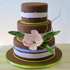 This chocolate black out cake with cookies and cream filling is decorated with chocolate fondant, pink, purple and green fondant ribbons and a single gumpaste Turkish tulip and leaves. Beautiful Wedding Cakes, Beautiful Cakes, Amazing Cakes, Grandma Birthday Cakes, Edible Creations, Chocolate Fondant, Chocolate Decorations, Just Cakes, Colorful Cakes