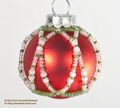 Free Beaded Ornament Cover Patterns | The completed ornament using green, crystal, and white seed beads.