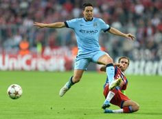 Philipp Lahm (R) and Manchester City's French midfielder Samir Nasri (L) challenge for the ball during the first leg UEFA Champions League Group E football match  FC Bayern Munchen v Manchester City in Munich, Germany on September 17, 2014.