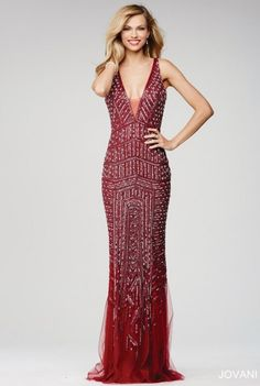 Style 20736 from Jovani is a gorgeous floor length sleeveless prom dress features a plunging neckline and beaded adornments.