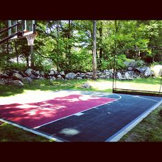 Basketball court with rebounder in CT. Neave Group used Flexcourt tiles.