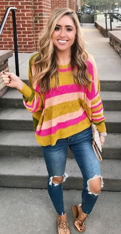 #fall #outfits women's brown and pink stripe sweatshirt and distress blue skinny jeans