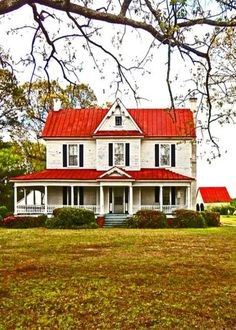Bright Red Roof On Old Farm House