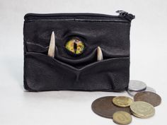 I found this really awesome Etsy listing at http://www.etsy.com/listing/167460684/change-purse-coin-purse-with-face-eye
