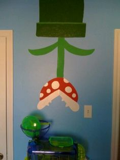 Mario Brothers flower - Use constraction papers to make it look like this then put it on the wall