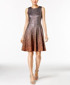 a4d9fd51320e5 All that glitters is golden on a festive Msk dress absolutely covered in  ombre sparkles for