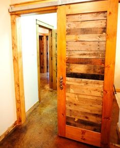Here's another unexpected project using wooden pallets. It's a reclaimed pallet wood door. Making something similar is simple. You need to find some old wooden doors and preserve only the frame. Then replace the missing pieces with wooden pallet slats. The door will instantly get a vintage, old-fashioned look.