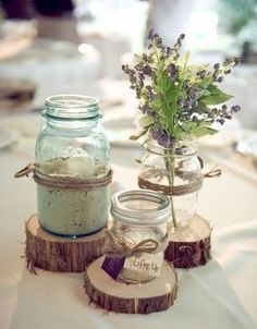 40 Creative And Cute Rustic Bridal Shower Ideas | HappyWedd.com - wood sliced coasters with mason jar vases and candles for a beach theme