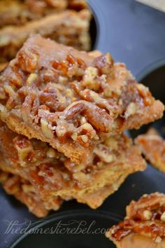 Pecan Pie Bark 2 sticks butter 1C  white sugar 1 1/4 C pecans halves Aprox 2 pkgs honey graham crackers 1. 325 degrees F. Lay your graham crackers tightly in lightly greased rimmed baking sheet. 2. bring the butter, sugar and pecans to a boil over medium heat for 3 minutes, stirring constantly. pour mixture over crackers, spreading pecans around evenly. Immediately pop into the oven and bake for 8 minutes. 3. Allow bark to cool completely before breaking into pieces and storing airtight.