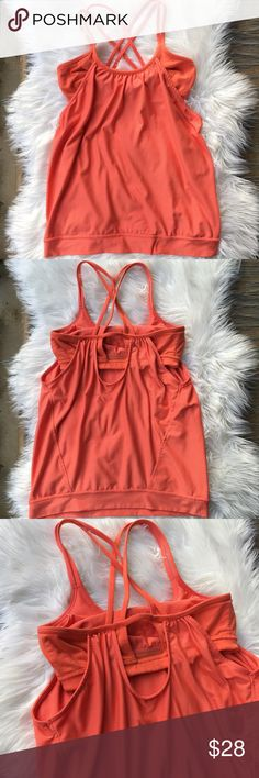 orange workout top with built in bra Item: Athleta workout top with built in bra  Color: orange  Size: SMALL  Condition: Preloved in great condition. Built in bra with holes for inserts. This doesn't come with inserts. Very flowy top with the bottom elastic band to hold it snug. Crisscross back straps. There a few small snags in the front of the top. See pics.  No trades Athleta Tops