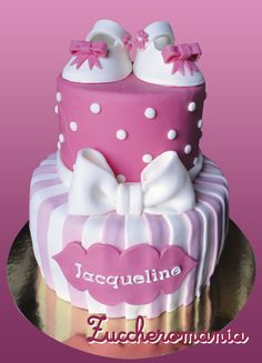 total pink with baby shoes cake