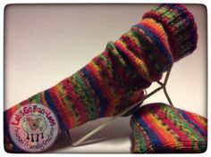 A pair of funky colourful socks hand knitted for you.  Knitted using Acrylic yarn.  This pair of socks are lovely and thick and will keep your feet lovely and warm.  They have been knitted circular so are seamless.  Will fit shoes size uk 5-7