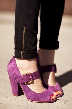 Purple peep-toe pumps.