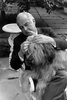 """Samuel Barber (1910–1981) was an American composer of orchestral, opera, choral, and piano music. He is one of the most celebrated composers of the 20th century; music critic Donal Henahan stated that """"Probably no other American composer has ever enjoyed such early, such persistent and such long-lasting acclaim. ● Samuel Barber going through a sheepdog's hair."""