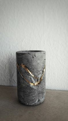 Vase from concrete with 24k gold, cement and gold