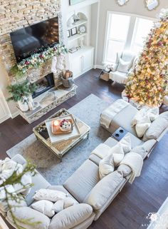 Two Story Christmas Living Room With Lazboy Sectional And Stacked Stone Fireplace Greatroom