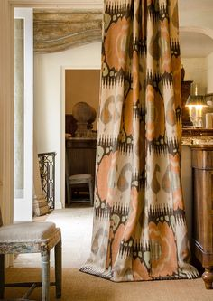 Kimono Linen Fabric from Lewis & Wood Big Prints Collection. A luxurious and appealingly muted ikat style large print fabric inspired by the Far East. In a rusty orange, beige, chocolate and green on a natural linen.
