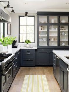 Dark cabinets look light and airy with glass cabinet doors & white interiors.