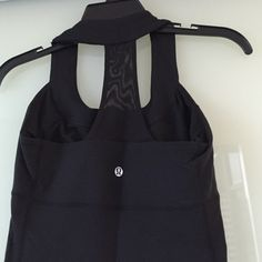 Lululemon athletica black tank top No rip out tag. In great condition! lululemon athletica Tops Tank Tops