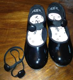 Tap Shoe Ties to replace shoelaces. Loop a black button through black elastic and then loop through the holes. Make sure your elastic is narrow enough to fit through button hole on the back of button!