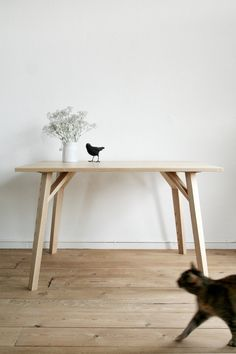 The Wooden Dinning Table Y is an ash wooden table that derives its strength and stability through the oblique Y-shaped legs.