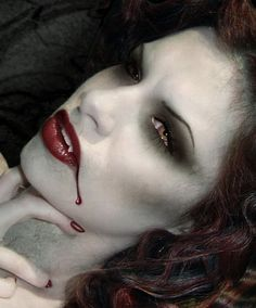 vampire makeup. not all that beautiful but I didn't know what board to put it on
