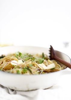 Buttery, lemony spring pasta, accentuated with radish sprouts and shaved parmesan