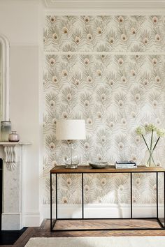 A stylised peacock feather wallpaper design by Harlequin with metallic hints and beaded highlights. Shown here in the Rose Gold/Pearl colourway. Vintage Bird Wallpaper, Pearl Wallpaper, Peacock Wallpaper, Neutral Wallpaper, Harlequin Wallpaper, Nursery Wallpaper, Kitchen Wallpaper, Wallpaper Ideas, Bird Bedroom