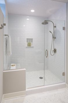All white bathroom with subway tile even on the ceiling. Sunfish Lake, MN | Martha O'Hara Interiors