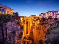 "Ronda, Spain This Andalucían city stands atop El Tajo gorge, which the Guadalevín River flows through. A jaw-dropping bridge connects the 15th-century ""new"" town from the old city that dates back to Moorish rule."