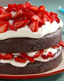 This simple chocolate cake is a favorite of Lucinda Scala Quinn's oldest son, Calder. Topped with whipped cream and sliced strawberries, it makes for an easy and delicious dessert.