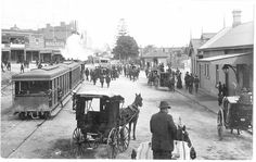 Railway Pde,Kogarah in southern Sydney in 1915,with the original railway station on the right,a steam-tram,buggies and on the left Stroud's Railway Hotel (now the Kogarah Hotel).The tower of the old Post Office is visible through the steam. •Kogarah Library•