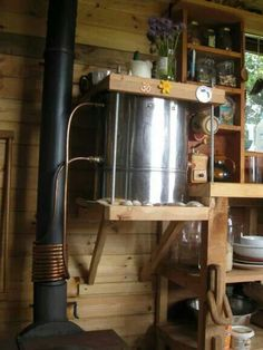 Wood stove heated water heater