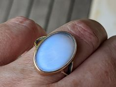 Antique Ceylon Blue moonstone ring in 9K gold. This is an extraordinary ring. The adularesence looks like an oval of blue sky and if you miss the summer during the winter, you should probably buy it. This effects sort of winks on and off according to the angle light hits it, and when its off, the