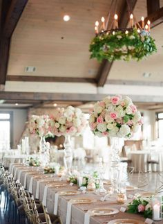 Gorgeous tall centerpieces in shades of pink and white float over the table | Foxhall Resort and Sporting Club, Atlanta Metro Venue | Justin Demutiis Photography