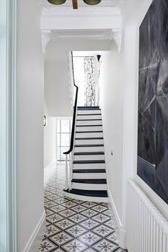 Step inside an art-filled Brooklyn townhouse. This gem will make art lovers swoon—step inside Townhouse Designs, House Design, House, Interior, Home, Victorian Hallway, Hall Tiles, Hallway Designs, White Staircase
