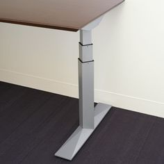 Here's a detail: height adjustable electric Dual stage T-leg base. Priority by Kimball Office.