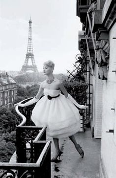Model at the Eiffel Tower, Plaza Athénée, Paris - 1958 - Photo by Christian Lemaire
