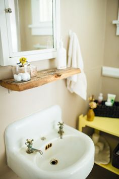 Design Sponge Bathrooms Impressive Small Bathroom With Mirror Hungribbon Via Designsponge Inspiration