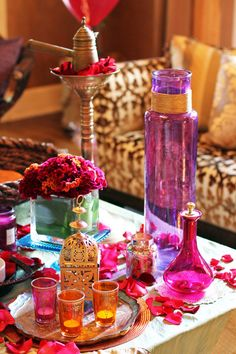 Moroccan Display I used Mod Podge glue and hot pink food coloring to dye the mini canister on the table, and then I spray painted the wood piece gold, Jessie says. The larger vase was already purple so I just painted some twine gold and wrapped Moroccan Party, Moroccan Style, Indian Style, Design Marocain, Morrocan Decor, Moroccan Bathroom, Boho Bathroom, Pink Food Coloring, Pink Foods